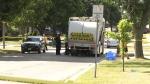 Pedestrian hit by garbage truck while walking dog