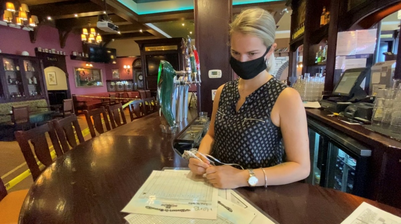 Heart & Crown Barrhaven General Manager Hollie Butcher looks over seating arrangements for Friday's reopening of bars. Ottawa, ON. July 14, 2020. (Tyler Fleming / CTV News Ottawa)