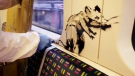 The artist Banksy painted rats before tagging the train with his moniker. (Banksy / Instagram)