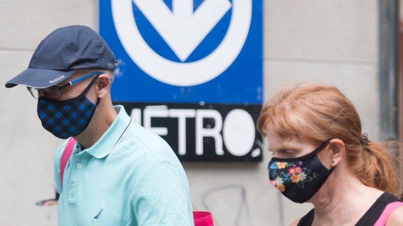 People wear face masks in Montreal, Sunday, July 12, 2020, as the COVID-19 pandemic continues in Canada and around the world. (THE CANADIAN PRESS / Graham Hughes)