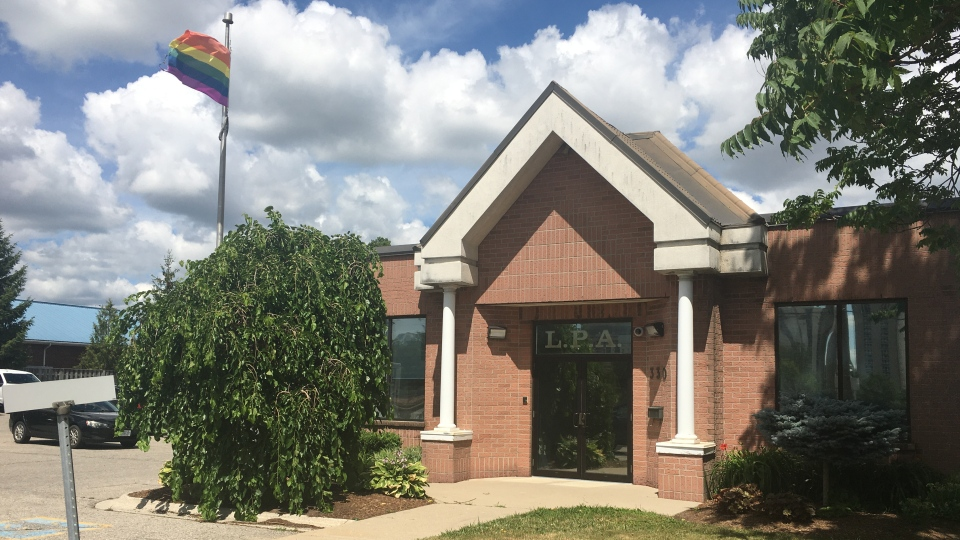 The rainbow Pride flag flies over London Police Association headquarters in London, Ont. on Tuesday, July 14, 2020. (Brent Lale / CTV News)