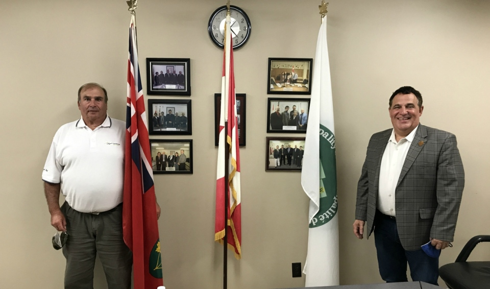 Markstay-Warren Mayor Steve Salonin, left, and Nickel Belt MP Marc Serre announced Tuesday Markstay-Warren is receiving $2.8 million from the federal government to cover the lion's share of a roads project. (Ian Campbell/CTV News)