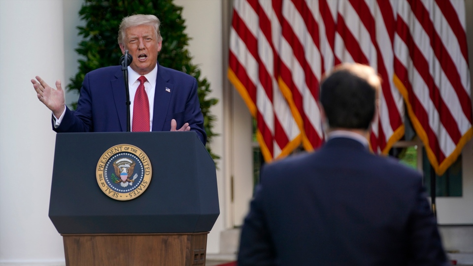 U.S. President Donald Trump speaks during a news conference in the Rose Garden of the White House, Tuesday, July 14, 2020, in Washington. (AP Photo/Evan Vucci)