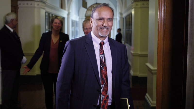 Surrey-Newton NDP MLA Harry Bains arrives to the start of the debate at B.C. Legislature in Victoria on June 26, 2017. Workers' compensation benefits in B.C. would be based on a higher maximum salary amount under legislation introduced Tuesday by the provincial government. (THE CANADIAN PRESS/Chad Hipolito)