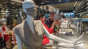 Mannequins at the Le Monarque restaurant are being used to help customers keep their social distancing Tuesday, July 14, 2020 in Montreal. The clothes will be auctioned off to raise money for charity.THE CANADIAN PRESS/Ryan Remiorz