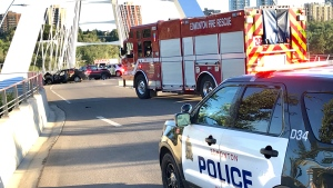 A serious collision involving a truck and a car closed the Walterdale Bridge, one person was seen on a stretcher. Tuesday July 14, 2020 (Sean Amato/CTV News Edmonton)