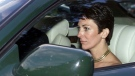 In this Sept. 2, 2000 file photo, British socialite Ghislaine Maxwell, driven by Britain's Prince Andrew leaves the wedding of a former girlfriend of the prince, Aurelia Cecil, at the Parish Church of St Michael in Compton Chamberlayne near Salisbury, England. (Chris Ison/PA via AP, File)