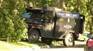 An armoured vehicle and a tactical team surrounded a house on 115 Avenue and 65 Street. Tuesday July 14, 2020 (Sean Amato/CTV News Edmonton)