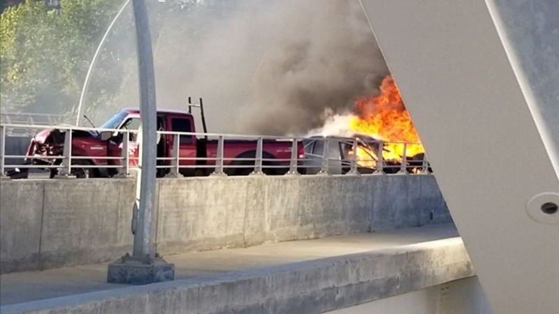 One person is dead after a crash on the Walterdale Bridge, one vehicle caught fire as a result of the crash. Tuesday July 14, 2020 (Courtesy: Rebecca-Lily Semotiuk)