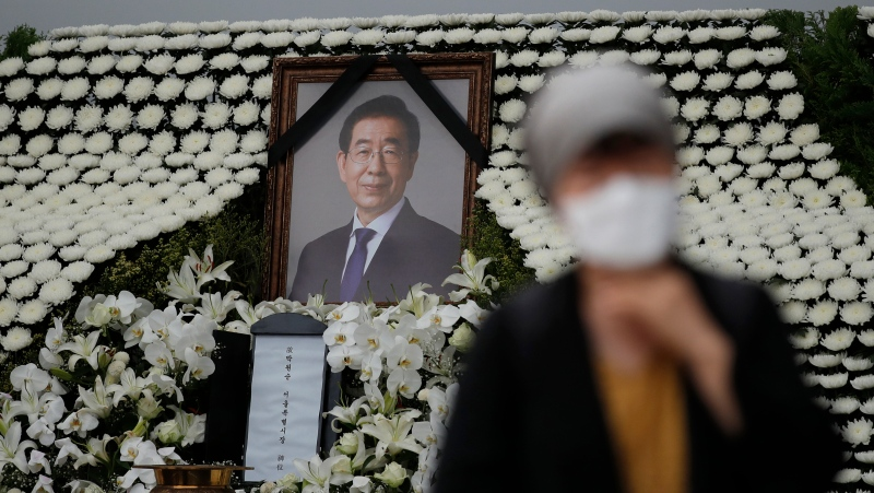A mourner passes by a memorial altar for late Seoul Mayor Park Won-soon at City Hall Plaza in Seoul, South Korea, Monday, July 13, 2020. (AP Photo/Lee Jin-man)