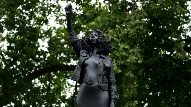 "A new black resin and steel statue entitled ""A Surge of Power (Jen Reid) 2020"" by artist Marc Quinn stands after the statue was put up this morning on the empty plinth of the toppled statue of 17th century slave trader Edward Colston, which was pulled down during a Black Lives Matter protest in Bristol, England, Wednesday, July 15, 2020. (AP Photo/Matt Dunham)"