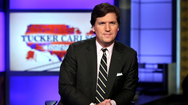 """FILE - In this March 2, 2017 file photo, Tucker Carlson, host of """"Tucker Carlson Tonight,"""" poses for photos in a Fox News Channel studio, in New York. (AP Photo/Richard Drew, File)"""