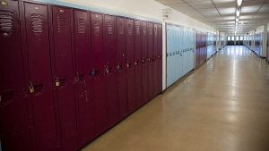 A empty hallway is pictured at Eric Hamber Secondary school in Vancouver, B.C. Monday, March 23, 2020. (Jonathan Hayward/The Canadian Press)