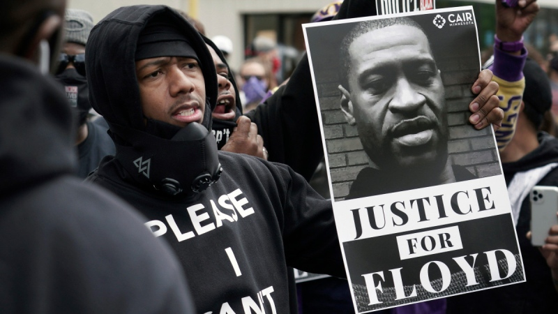 Nick Cannon celebrates the memory of George Floyd on Chicago Avenue in Minneapolis, on May 29, 2020. (Brian Peterson / Star Tribune via AP)