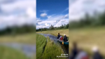 A group of friends paddled their canoe down a water-filled ditch near Redwater.