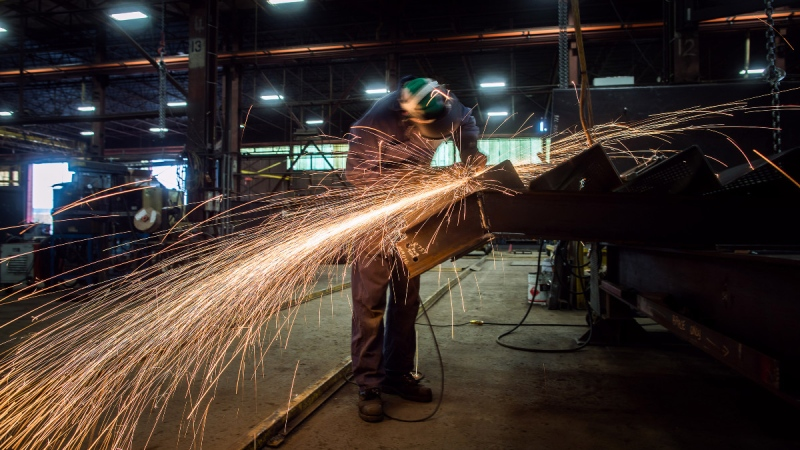 Fabricator Mike Caldarino uses a grinder at George Third & Son Steel Fabricators and Erectors, in Burnaby, B.C., on March 29, 2018. (Darryl Dyck / THE CANADIAN PRESS)