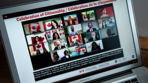 Participants celebrate becoming Canadian citizens after swearing the oath of citizenship during a virtual citizenship ceremony held over livestream due to the COVID-19 pandemic, on Canada Day, Wednesday, July 1, 2020, seen on a computer in Ottawa. (THE CANADIAN PRESS / Justin Tang)