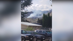 A small wildfire is seen near a Kamloops composting facility. (BC Wildfire Service/Twitter)