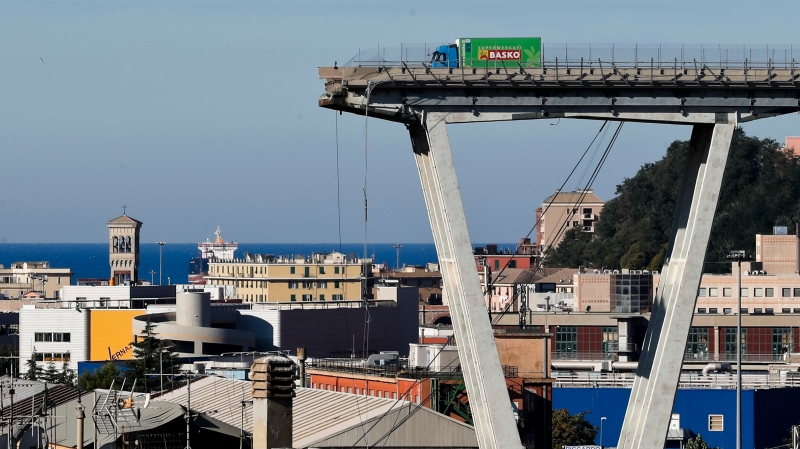 A Wednesday, Aug. 15, 2018 file photo showing a view of the Morandi highway bridge that collapsed in Genoa, northern Italy. (AP Photo/Antonio Calanni, File)