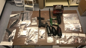 Steinbach RCMP found paintball guns, knives, and a pellet gun, after searching a vehicle on July 12. (Source: RCMP)