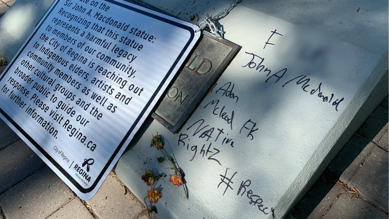 A statue of Sir John A. Mcdonald was vandalized in Regina's Victoria Park. (Michaela Solomon / CTV News Regina)
