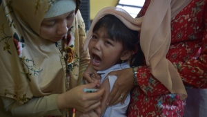 Three-quarters of more than 80 nations responding to UN survey said that the COVID pandemic had disrupted immunization programs. (AFP)