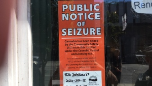 A public notice of seizure has been posted on the dispensary's door, notifying passersby that cannabis has been seized from the property at 826 Johnson St. (CTV News)