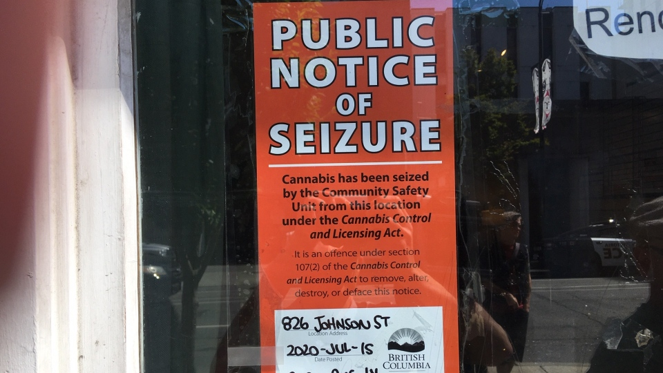 A public notice of seizure has been posted on the dispensary's door, notifying passersby that cannabis has been seized from the property at 826 Johnson St.: July 15, 2020 (CTV News)
