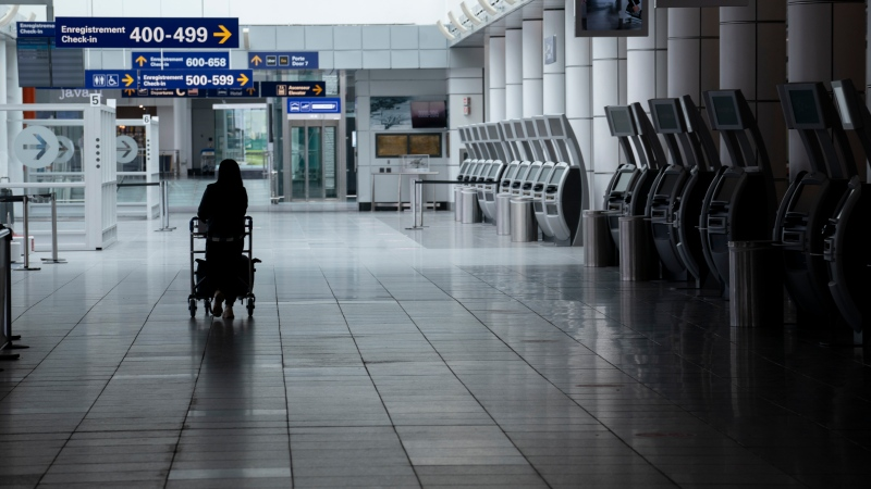 A lone passenger is seen at Montreal's Trudeau International Airport on Tuesday, June 2, 2020. (THE CANADIAN PRESS / Paul Chiasson)