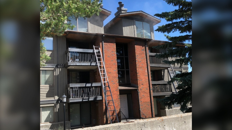 Ladders extended to the third storey balconies of the Kingston Court apartment building during the CFD response to a fire on July 15, 2020