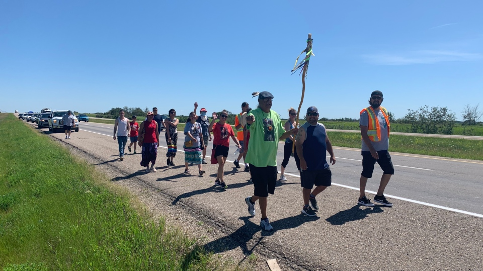 Family and friends of Ashley Morin walk on Highway 16 toward North Battleford on July 12, 2020. (Creeson Agecoutay/CTV Saskatoon)