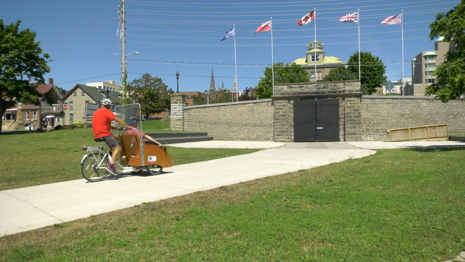 Greg McElrea drives Handy Nevers around in a Trishaw near Brockville's train tunnel July 15, 2020. (Nate Vandermeer / CTV News Ottawa)