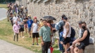 Hundreds of people line up at the Hotel Dieu COVID-19 testing clinic Wednesday, July 15, 2020 in Montreal. The city has recommended that anyone who has been in a bar since July 1, 2020 to get tested. THE CANADIAN PRESS/Ryan Remiorz