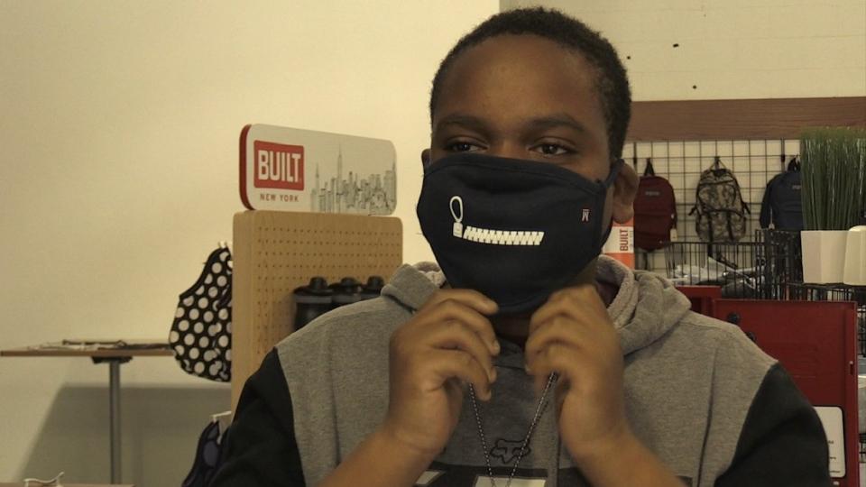 Student Daniel Cornwall wears a mask
