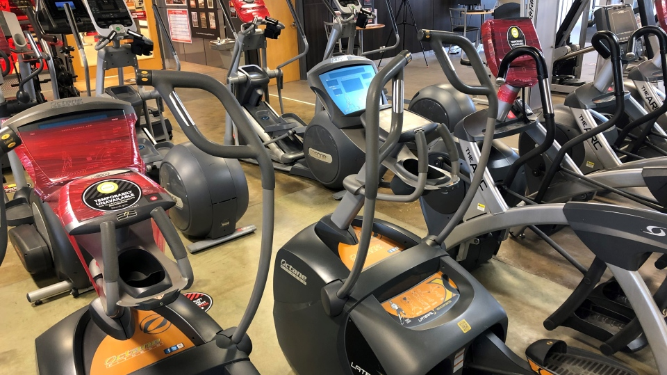 Every other elliptical machine at GoodLife Fitness will be taped off to encourage physical distancing during Stage 3 of reopening. (Dave Charbonneau / CTV News Ottawa)