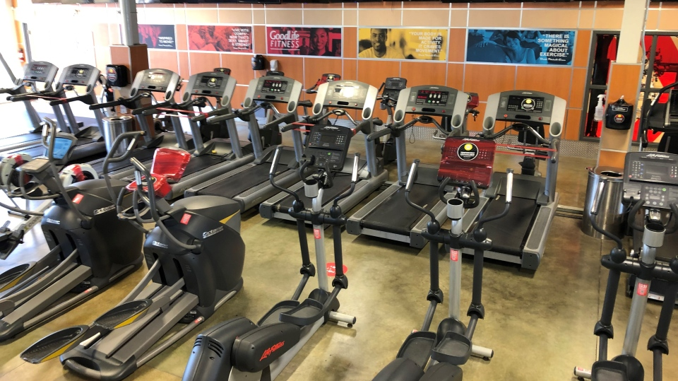 Every second cardio machine at GoodLife Fitness clubs will be taped off to promote physical distancing when the clubs reopen on Friday. (Dave Charbonneau / CTV News Ottawa)