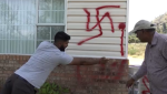 The Lekhi family in Summerland, B.C. surveys racist graffiti that was left on their home this week.