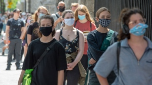 Hundreds of people lineup at the COVID-19 testing clinic Tuesday, July 14, 2020 in Montreal. The city has recommended that anyone who has been in a bar since July 1, 2020 to get tested.THE CANADIAN PRESS/Ryan Remiorz