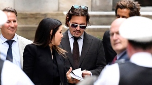"Actor Johnny Depp leaves the High Court in London, Wednesday July 15, 2020. Depp is suing News Group Newspapers, publisher of The Sun, and the paper's executive editor, Dan Wootton, over an April 2018 article that called him a ""wife-beater."" (Kirsty O'Connor/PA via AP)"
