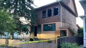 Police tape outside of a home on 9A St N.E. in Bridgeland on July 16, 2020 following a fatal overnight fire