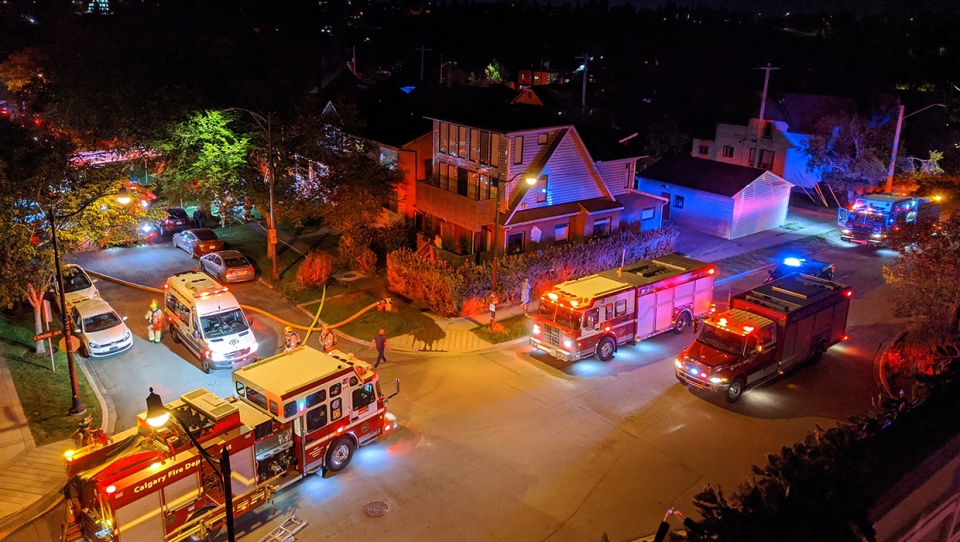 Emergency crews at the scene of Wednesday night's fire at a Bridgeland home that left one man dead (Photo: Ryan Lisowski)