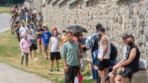 Hundreds of people line up at the COVID-19 testing clinic Wednesday, July 15, 2020 in Montreal. The city has recommended that anyone who has been in a bar since July 1, 2020 to get tested. THE CANADIAN PRESS/Ryan Remiorz