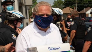 Ontario Premier Doug Ford holds a box of pastries after visiting a bakery in Toronto, on Friday, July 10, 2020. (THE CANADIAN PRESS/Chris Young)