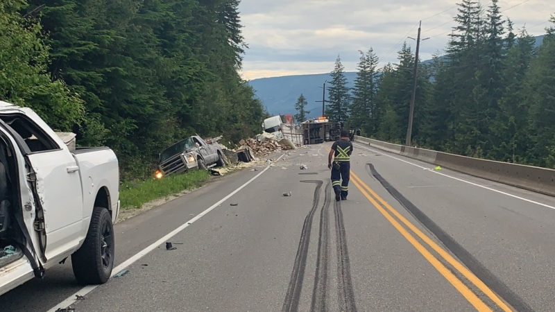 Damaged vehicles, brake marks on the highway and a field of debris following a July 15 crash on the Trans-Canada Highway west of Sicamous, B.C. (RCMP)