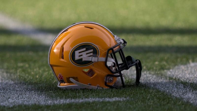 A Edmonton Eskimos helmet is seen on the field during a team practice session in Winnipeg, Man. Friday, Nov. 27, 2015. The Edmonton Eskimos will play the Ottawa Redblacks in the 103rd Grey Cup Sunday. THE CANADIAN PRESS/Darryl Dyck