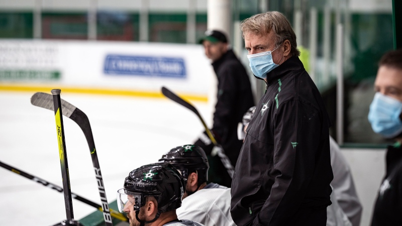 In this photo provided by the Dallas Stars NHL hockey team, interim head coach Rick Bowness watches practice in Frisco, Texas, Tuesday, July 14, 2020. (Jeff Toates/Dallas Stars via AP)