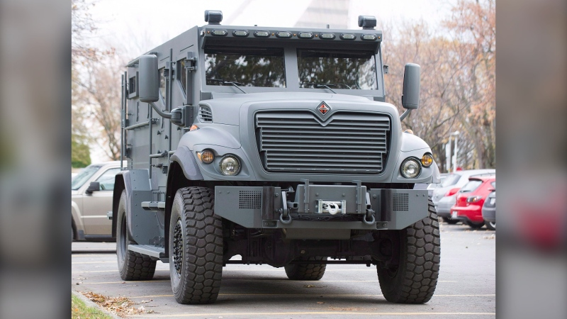 The Montreal Police department's new armoured vehicle is shown at a press launch in Montreal, Wednesday, Nov. 6, 2013. (THE CANADIAN PRESS/Graham Hughes)