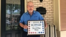 Keith Tapp, who has participated in the 'Marathon of Hope' for decades, shows off his commemorative stickers in London, Ont. on Thursday, July 16, 2020. (Reta Ismail / CTV News)