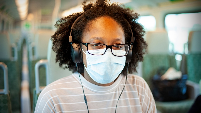 A woman is seen wearing a face mask onboard a GO Transit vehicle. (Metrolinx)