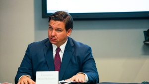 Florida Gov. Ron DeSantis and First Lady Casey DeSantis hold a roundtable discussion regarding mental health and COVID-19 at the Tampa Bay Crisis Center on Thursday, July 16, 2020 in Tampa. (Martha Asencio-Rhine/Tampa Bay Times via AP)